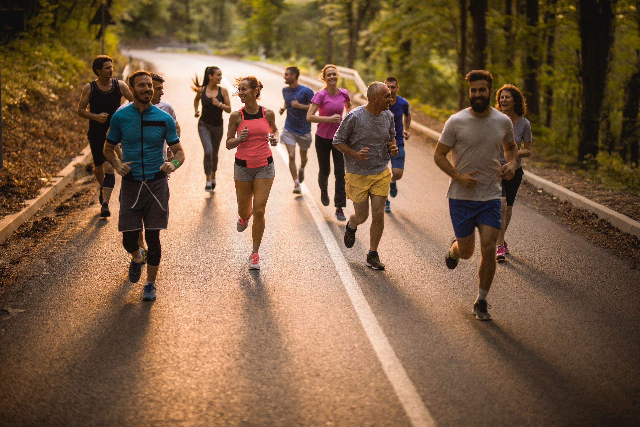 large-group-of-athletes-talking-while-having-a-road-royalty-free-image-1568746096