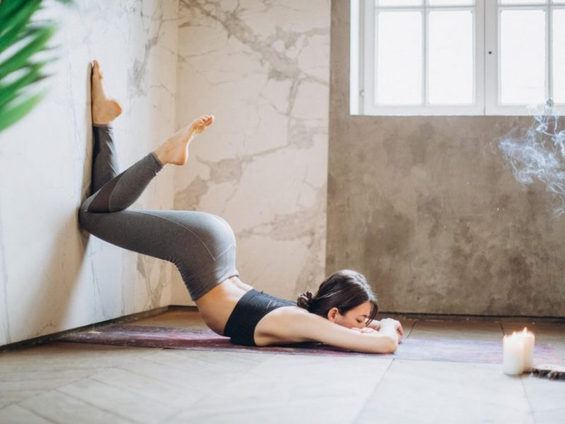 woman doing yoga in the morning