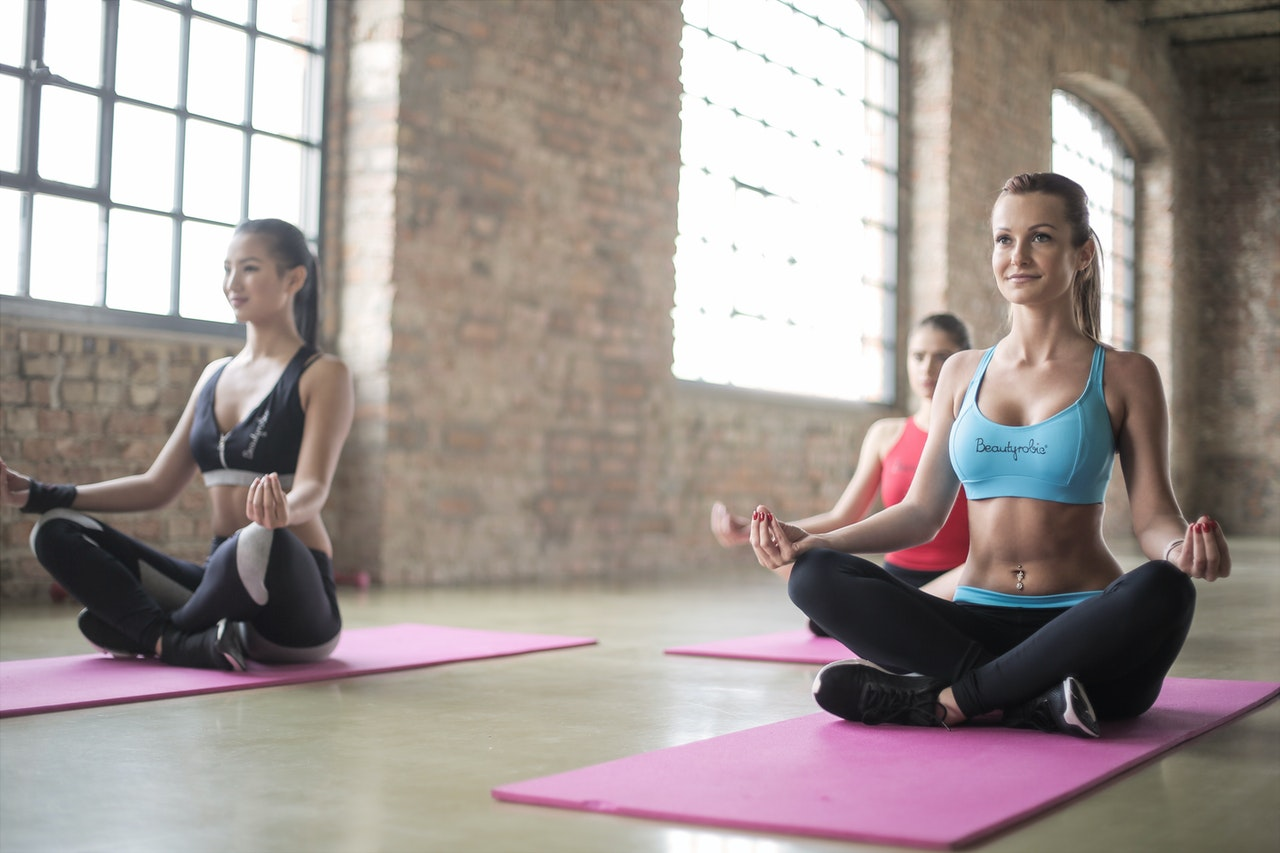 two women doing yoga and pilates